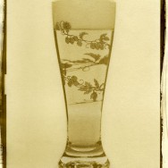 Van Dyke Brown Printing of a glass of beer. The glass has a hop motif, a vine of hops wrapping around the body.